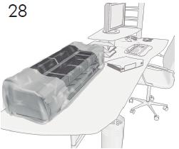 T100のみ: プリンタを最終的に設置する場所( 机 の上またはテーブルの上)に移動します。